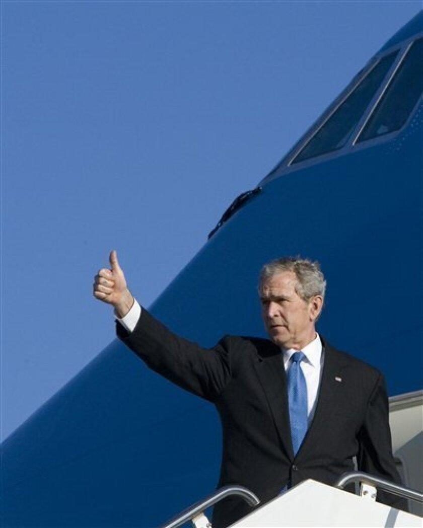 President George W. Bush gives a thumbs up as he boards Air Force One, Saturday, Jan. 10, 2009, in Norfolk, Va.   (AP Photo/Haraz N. Ghanbari)