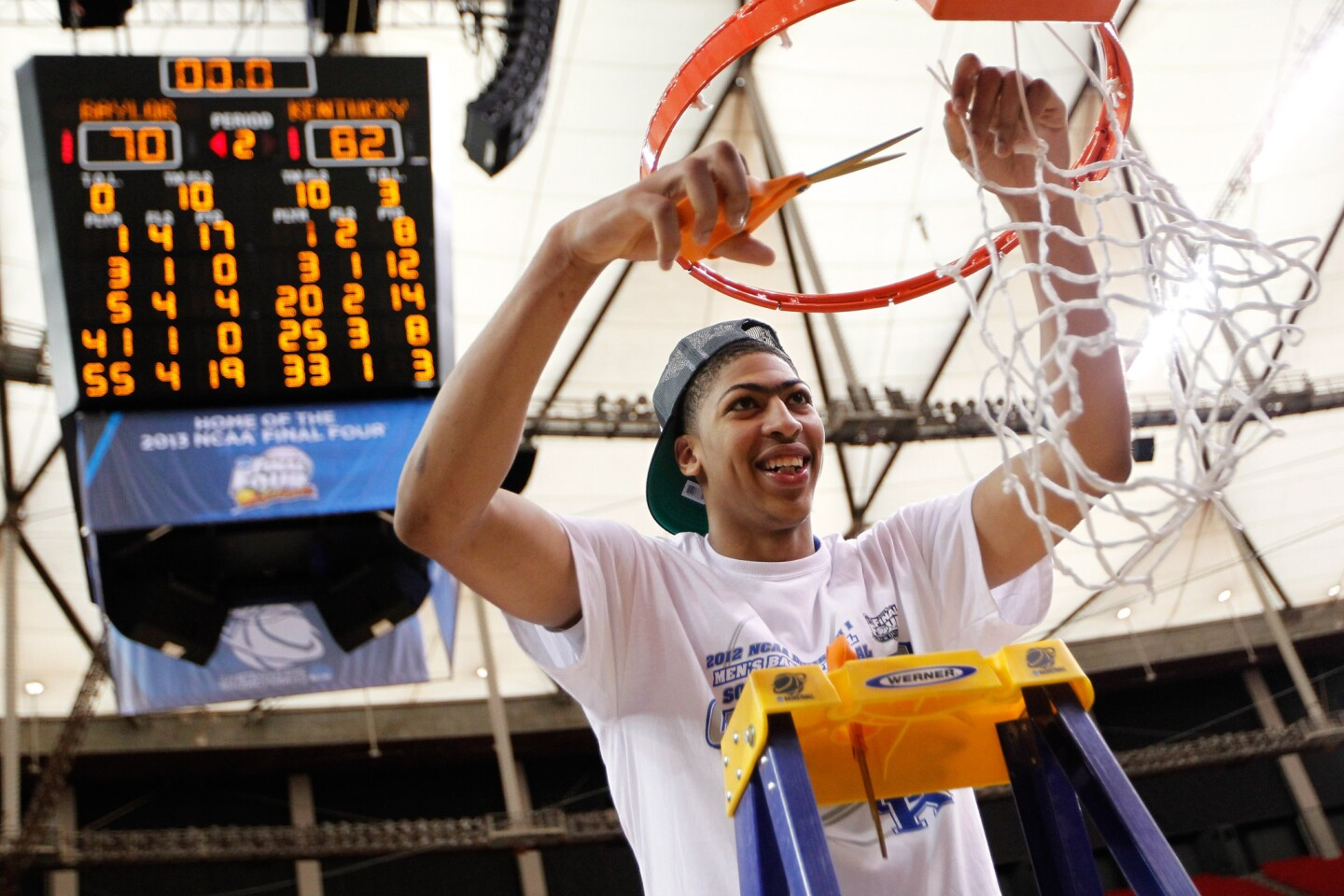 Anthony Davis cuts down the net after Kentucky defeated the Baylor 82-70 in the NCAA tournament South Regional final on March 25, 2012, in Atlanta.