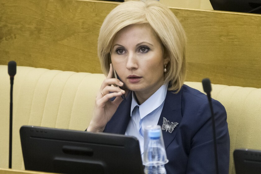 Russian lawmaker Olga Batalina, one of the bill's co-authors, speaks on a phone at the State Duma in Moscow on Friday.