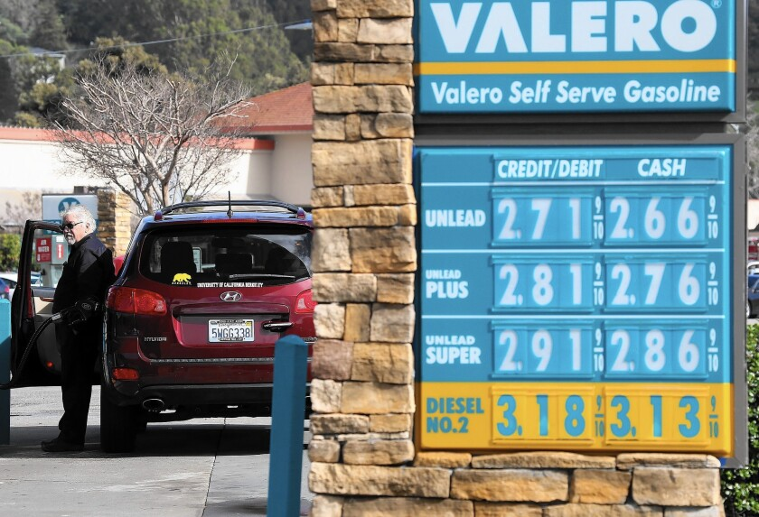 Gasoline prices are displayed at a Valero gas station in San Rafael, Calif., in February.