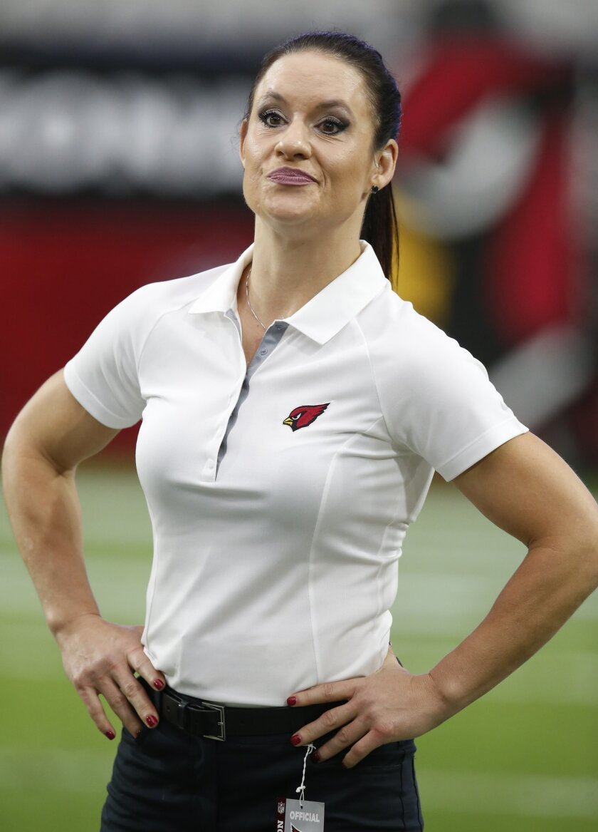FILE - In this Aug. 15, 2015, file photo, Arizona Cardinals coach Jen Welter is shown prior to an NFL preseason football game against the Kansas City Chiefs in Glendale, Ariz. Her groundbreaking stint as coaching intern with the Arizona Cardinals is nearing an end, and Jen Welker has one word to describe the experience _ ``Fantastic.'' (AP Photo/Rick Scuteri, File)