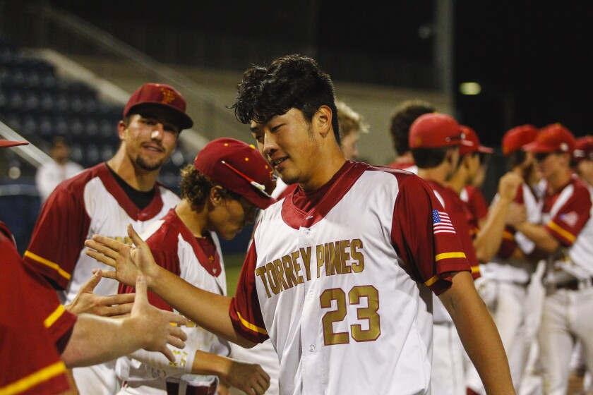 Torrey Pines' Kevin Sim high fives teammates during the awards ceremony.