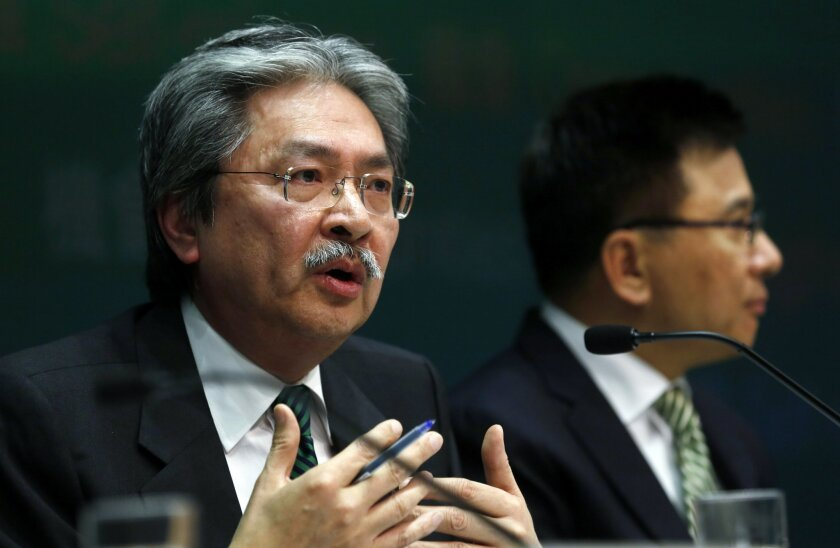 Hong Kong's Financial Secretary John Tsang speaks to the media during a news conference after delivering his budget speech in Hong Kong Wednesday, Feb. 26, 2014. Hong Kong's finance chief forecasts that the economy of the Asian financial center could grow up to 4 percent this year after expanding 2.9 percent in 2013. (AP Photo/Kin Cheung)