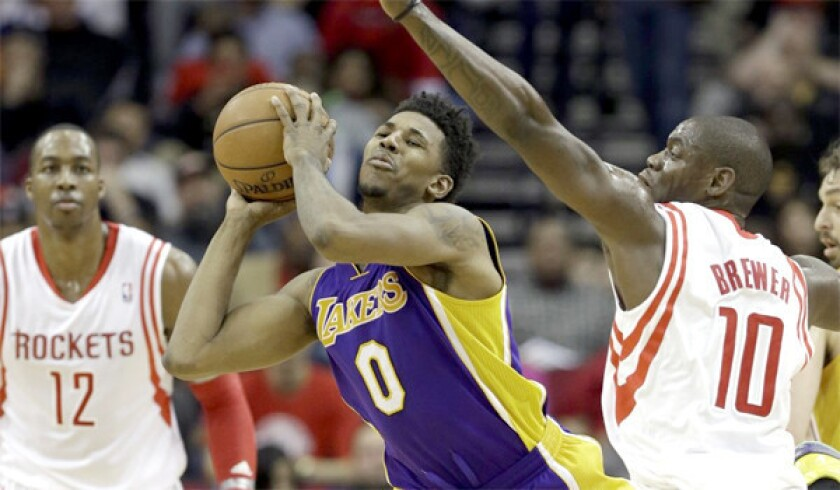 Nick Young looks to pass during the Lakers' loss to the Rockers, 113-99, last Wednesday.