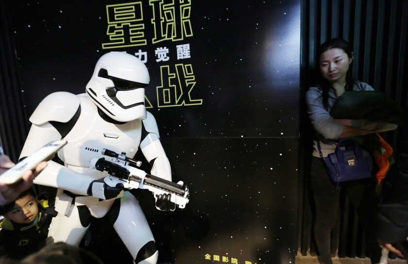"""""""Star Wars: The Force Awakens"""" earned $44 million last week at the Chinese box office. Above, filmgoers at a cinema in Beijing."""