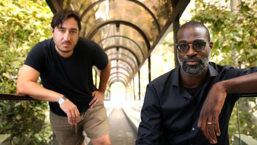 Ed Droste of Grizzly Bear, left, and TV on the Radio's Tunde Adebimpe at the Hollywood Bowl, where they're due to play a joint concert on Sunday.