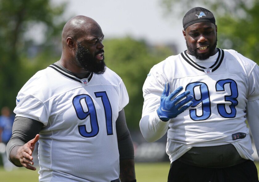 Detroit Lions defensive tackle A'Shawn Robinson (91) talks with Tyrunn Walker after NFL football practice in Allen Park, Mich., Thursday, May 26, 2016. (AP Photo/Paul Sancya)