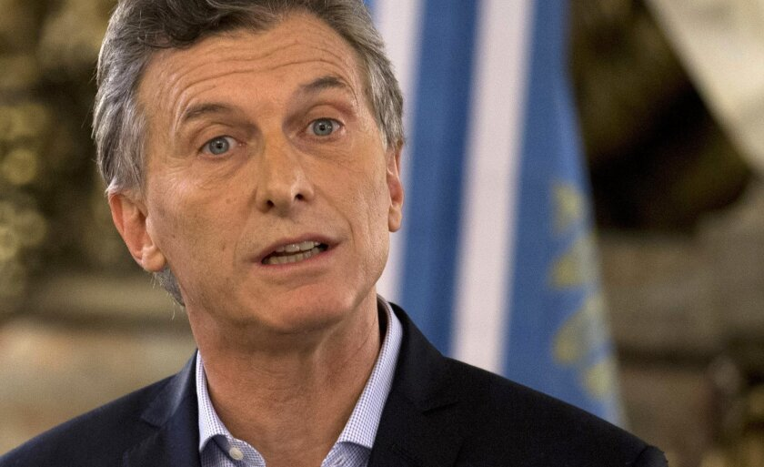 FILE - In this April 7, 2016 file photo, Argentina's President Mauricio Macri speaks at the government house in Buenos Aires, Argentina. Macri said Monday, May 30, that he will repatriate $1.3 million in savings from the Bahamas. He also said he will use the money to buy Argentine treasury bonds because he is confident the country's economy will recover and thrive. (AP Photo/Natacha Pisarenko, File)
