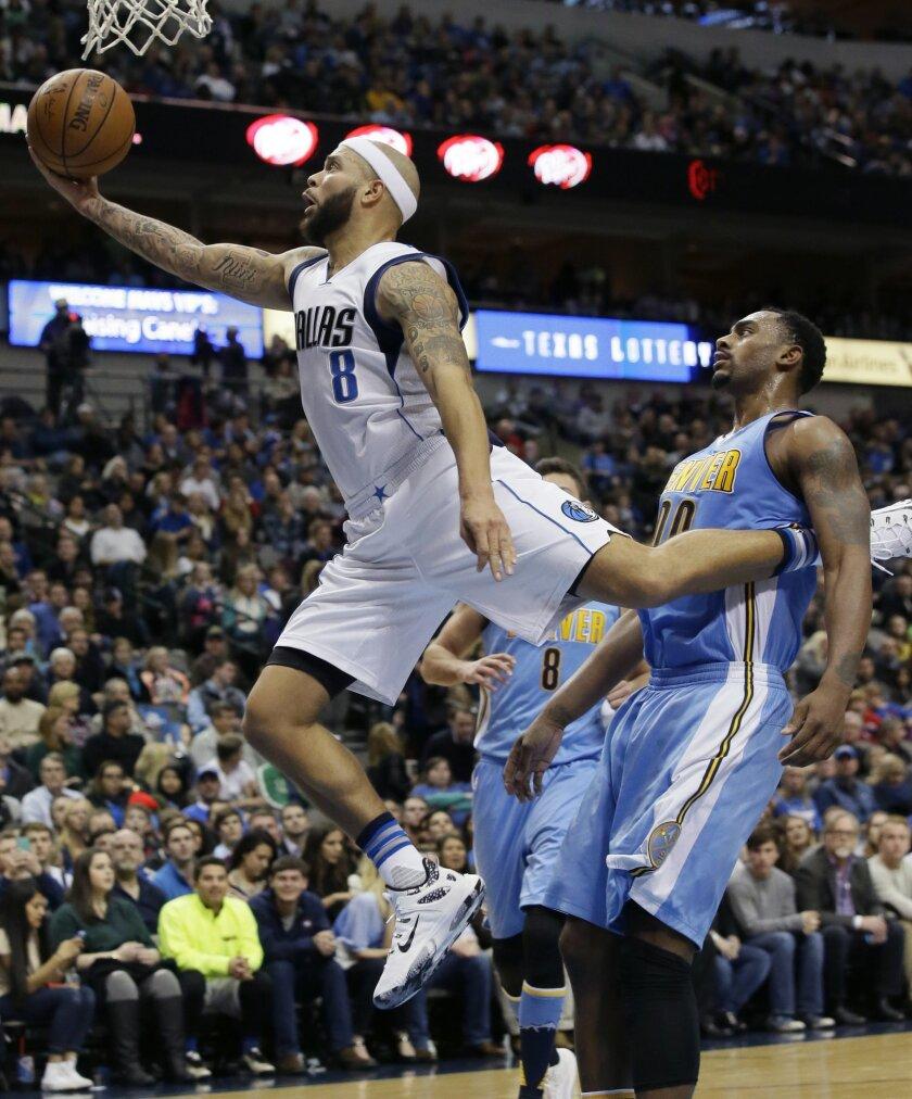 Dallas Mavericks guard Deron Williams (8) drives past Denver Nuggets forward Darrell Arthur (00) during the second half of an NBA basketball game Saturday, Nov. 28, 2015, in Dallas. The Mavericks won 92-81.(AP Photo/LM Otero)