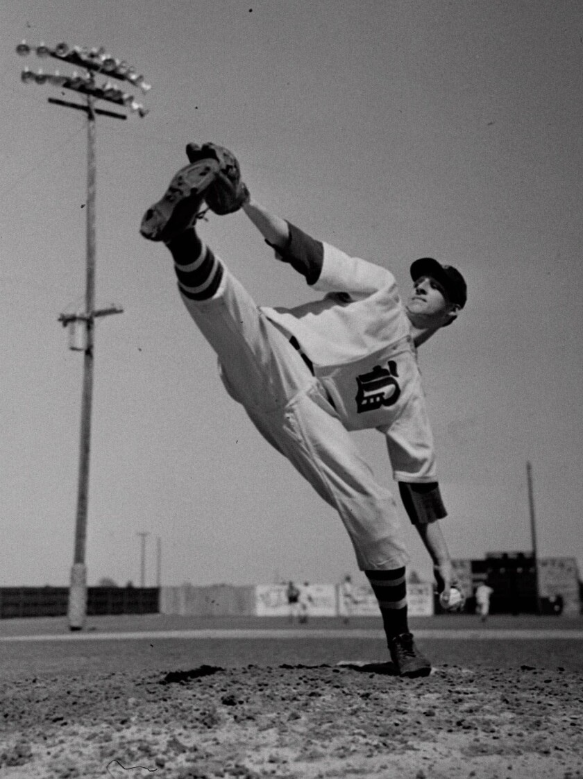 Warren Spahn tries out for the Boston Braves at a winter camp in Florida in 1942.