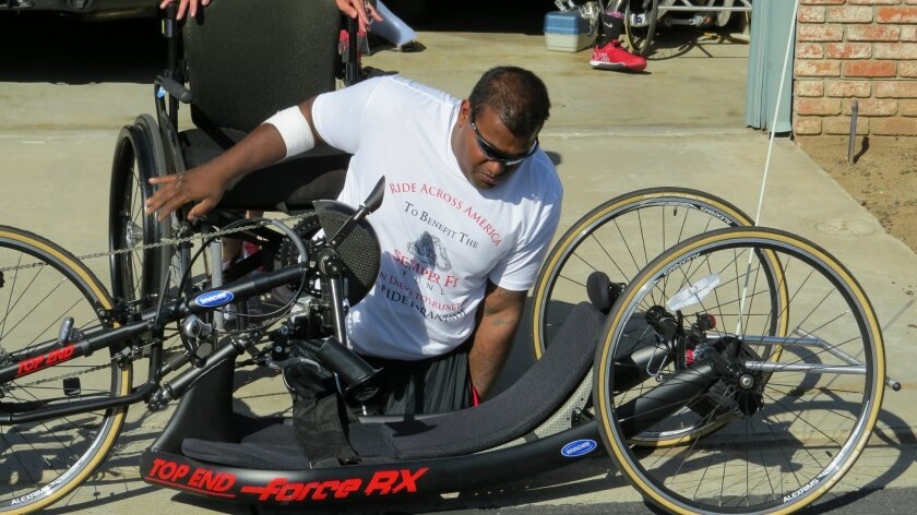 USMC Sgt Ret. Toran Gaal, with one of the three recumbent bicycles he'll use during his trip across the country.