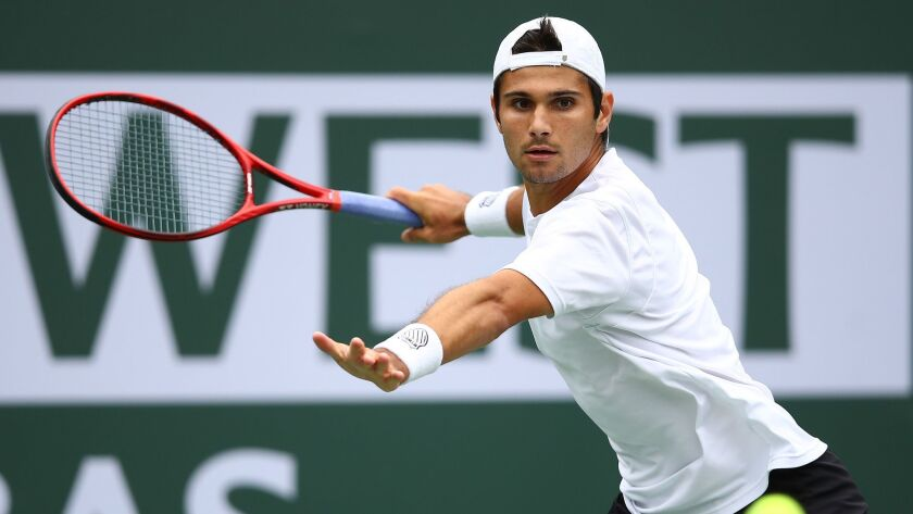 Marcos Giron plays a forehand against Milos Raonic during Giron's third-round loss at Indian Wells on Monday.
