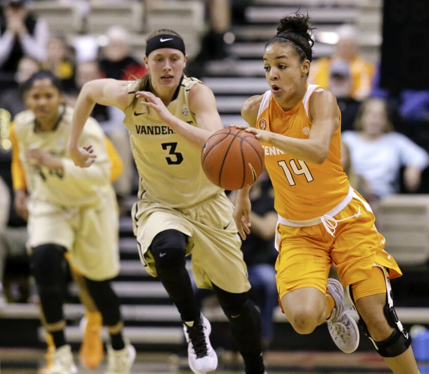 Tennessee guard Andraya Carter (14) takes the ball down the court ahead of Vanderbilt guard Rachel Bell (3) in the first half of an NCAA college basketball game Thursday, Feb. 11, 2016, in Nashville, Tenn. (AP Photo/Mark Humphrey)