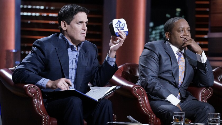 "Mark Cuban, left, and Daymond John look at a modern Paleo diet food in ""Shark Tank"" on ABC."