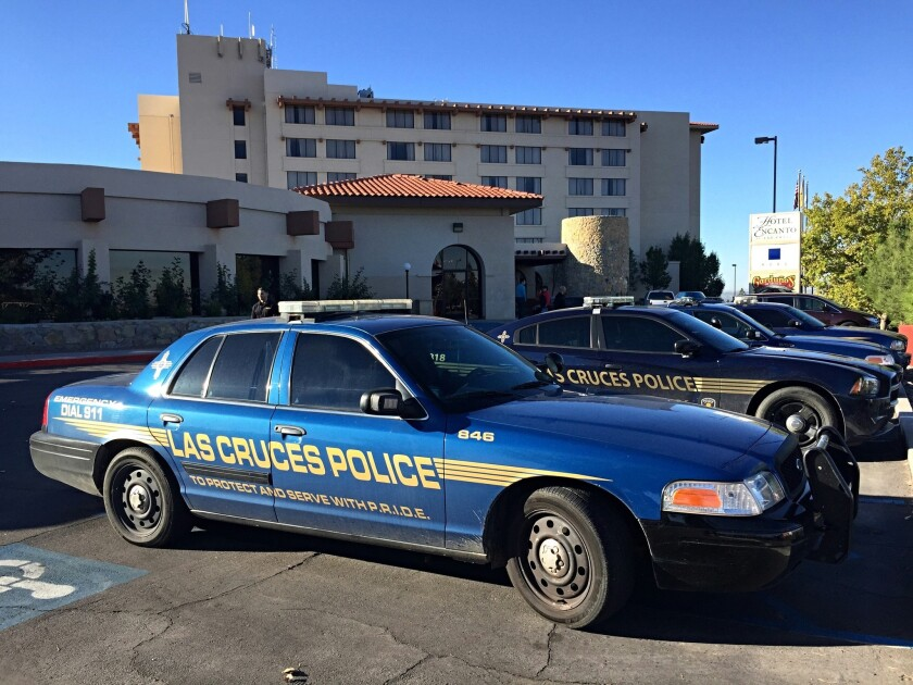 Las Cruces police investigate a shooting scene at the Hotel Encanto in Las Cruces, N.M., on Oct. 28. A Santa Fe County sheriff's deputy is thought to have shot and killed a fellow deputy at the hotel.