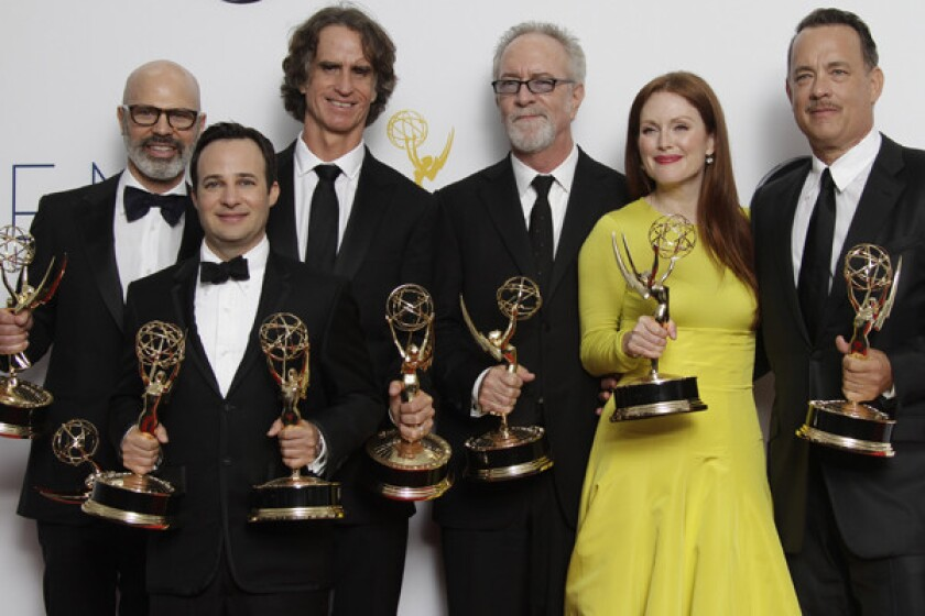 """Members of """"Game Change"""" celebrate their multiple Emmys."""