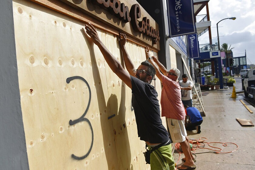 A store in Hamilton, Bermuda, is boarded up Sept. 18 in preparation for Hurricane Humberto.