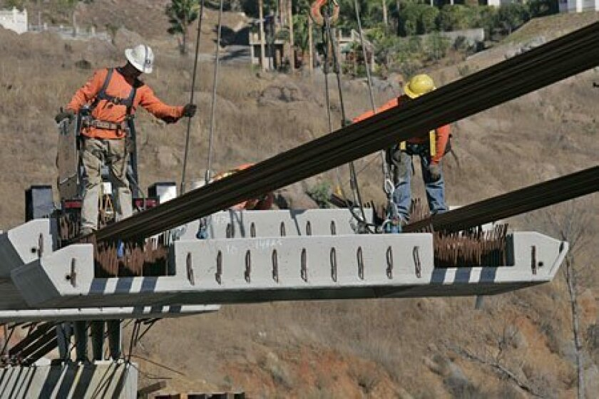 <strong>HEAVY INDUSTRY:</strong> President-elect Barack Obama has vowed to spend hundreds of billions on infrastructure. (John Gibbins / Union-Tribune)