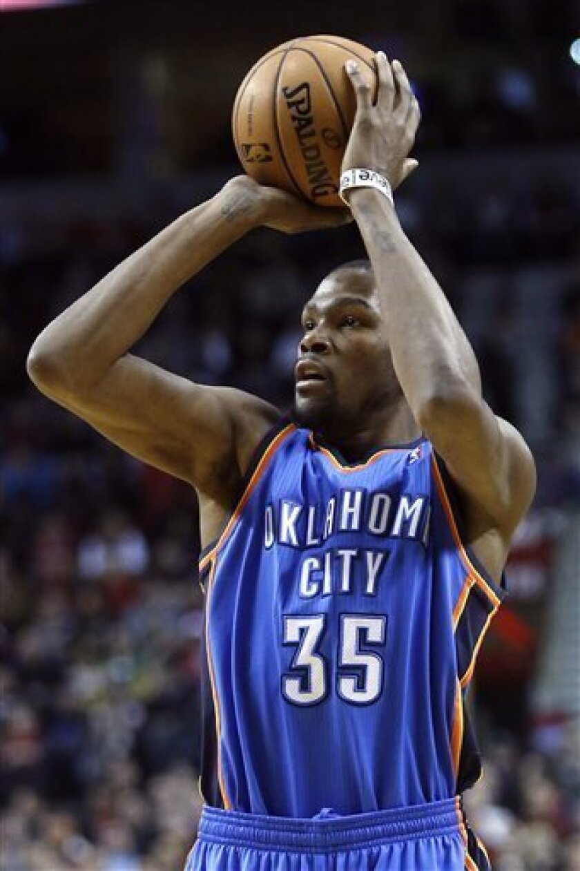 Oklahoma City Thunder forward Kevin Durant shoots during the first quarter of an NBA basketball game against the Portland Trail Blazers in Portland, Ore., Sunday, Jan. 13, 2013. (AP Photo/Don Ryan)