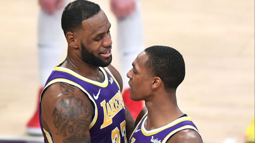 LOS ANGELES, CALIFORNIA MARCH 6, 2019-Lakers LeBron James, left, is congratulated by Rajon Rondo af