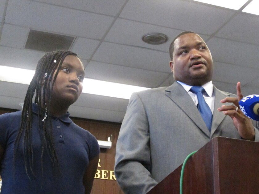 In this Oct. 4, 2019 photo, Marty Small speaks at a swearing-in ceremony in Atlantic City, N.J. that installed him as acting mayor following the resignation of Mayor Frank Gilliam Jr.who admitted stealing $87,000 from a youth basketball team. On Tuesday Oct. 15, 2019, the City Council is expected to choose Small to be mayor until the Nov. 2020 general election. Listening is his daughter Jada, left. (AP Photo/Wayne Parry)