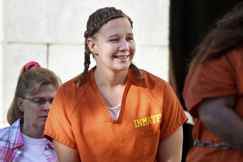 FILE- In this June 26, 2018 file photo, Reality Winner walks into the Federal Courthouse in Augusta, Ga. Winner, 29, a former government contractor who was given the longest federal prison sentence imposed for leaks to the news media, has been released from prison to home confinement, a person familiar with the matter told The Associated Press on Monday. (Michael Holahan/The Augusta Chronicle via AP, File)