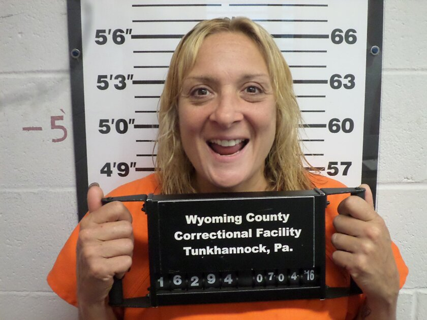This undated photo provided by the Wyoming County Correctional Facility in Tunkhannock, Pa., shows Kimberly Brinton of Meshoppen, Pa. Brinton was jailed on aggravated assault and other charges after police say she sprayed gasoline on another woman who criticized her for smoking a cigarette while pu