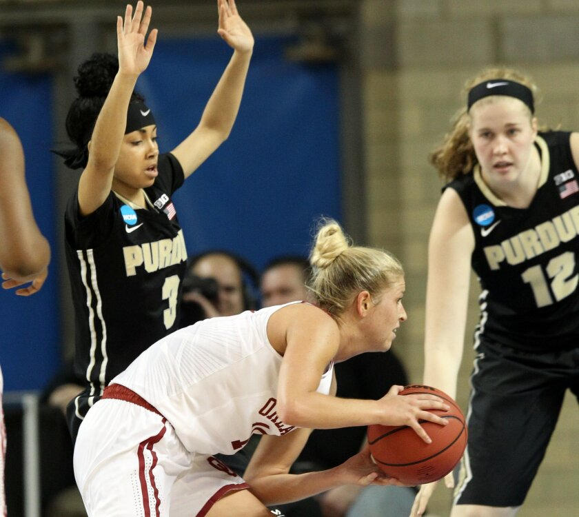 Oklahoma's Peyton Little, middle, looks for an opening between Purdue's Tiara Murphy (3) and Nora Kiesler (12) during a first round women's college basketball game in the NCAA Tournament in Lexington, Ky., Saturday, March 19, 2016. Oklahoma won 61-45. (AP Photo/James Crisp)