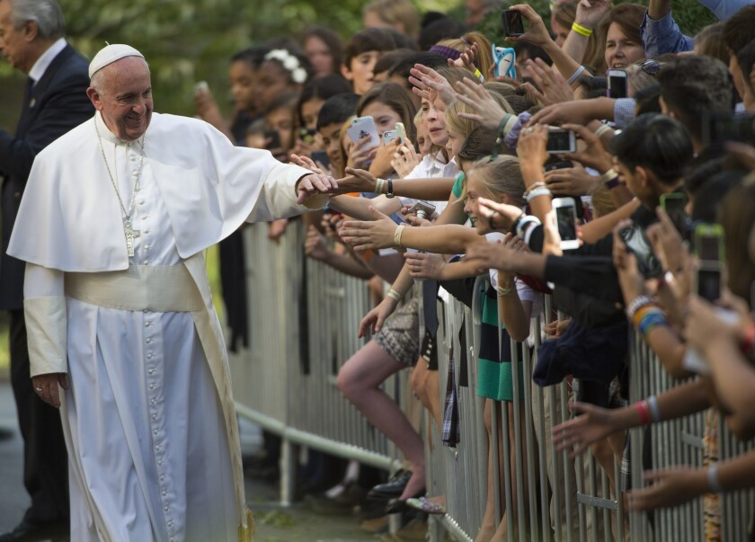Pope Francis greets well-wishers as he leaves the Nunciature in Washington on Sept. 24.