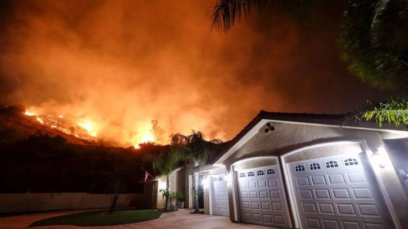 The Holy fire burns near homes in the Cleveland National Forest near Lake Elsinore on Aug. 9.