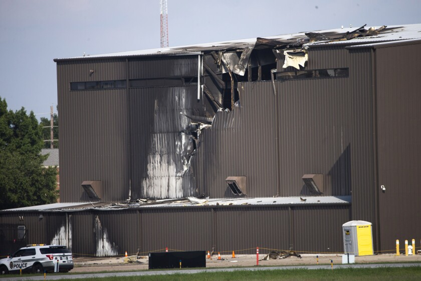 FILE - In this June 30, 2019, file photo, damage is seen to a hangar after a twin-engine plane crashed into the building at Addison Airport in Addison, Texas. The pilot's failure to control a small airplane when it lost thrust in one of two engines seconds after takeoff in suburban Dallas led to the crash that killed all 10 people aboard, federal officials said in a report Tuesday, May 18, 2021. (Shaban Athuman/The Dallas Morning News via AP, File)