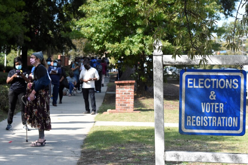 Voters wait in line outside the Richland County election office