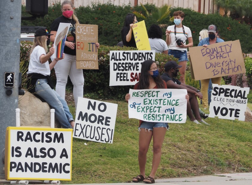 San Dieguito Union High School District students protest at the district office on April 11.