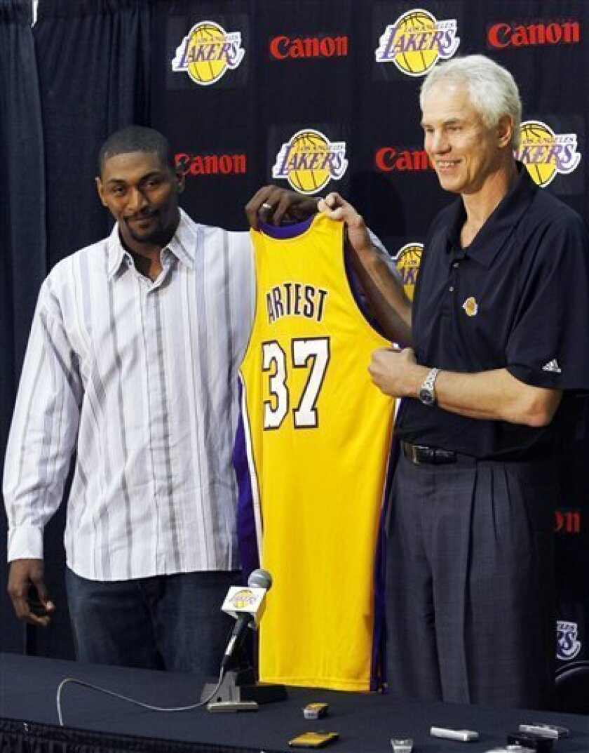 Ron Artest, left, appears with Los Angeles Lakers general manager Mitch Kupchak to announce that he has signed with the Los Angeles Lakers in Los Angeles, Wednesday, July 8, 2009. The 6-foot-7 forward earned $7.4 million in his only season with Houston, averaging 17.1 points, 5.2 rebounds and 3.3 assists. Artest has averaged 16.1 points and 5.1 rebounds in 10 seasons with Chicago, Indiana, Sacramento and Houston and was named 2004 Defensive Player of the Year. (AP Photo/Philip Scott Andrews)