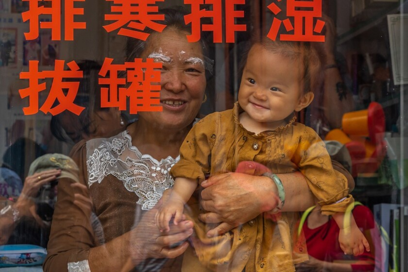 Don Drissel of Seal Beach was in a local market in Xizhou, China, when he spotted this child through a window. Drissel waved, got the grin in return, and snapped this photo, included in the 2018 reader photo issue.