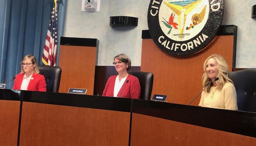 Board members of the Clean Energy Alliance meet in Carlsbad on Dec. 19, 2019. From left, Cori Schumacher, chair and Carlsbad city council member; Ellie Haviland, vice chair and deputy mayor of Del Mar; and Kristi Becker, Solana Beach city council member.