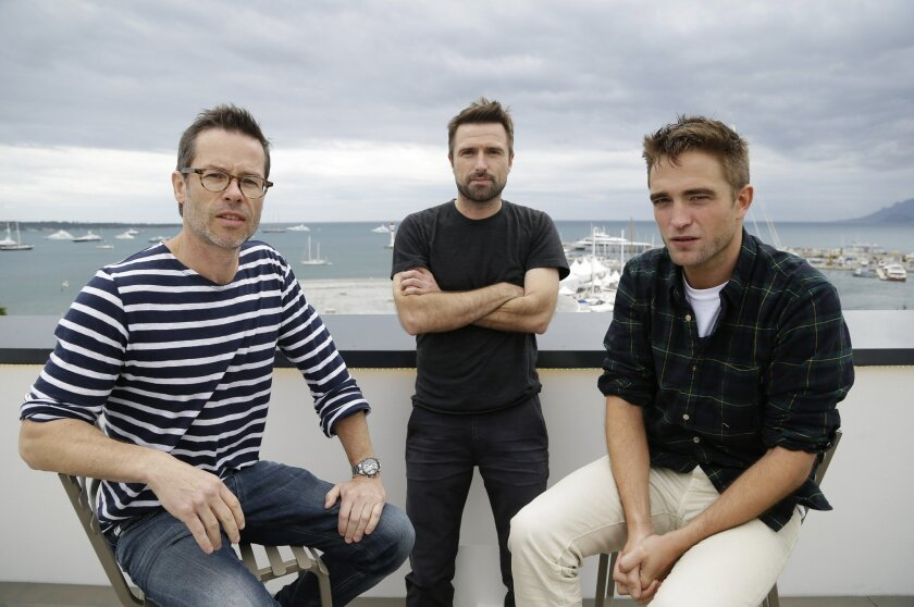 """FILE - In this May 19, 2014 file photo, from left, actor Guy Pearce, director David Michod and actor Robert Pattinson pose for a portrait to promote """"The Rover,"""" at the 67th international film festival, Cannes, southern France. Four years after his breakthrough debut feature film """"Animal Kingdom,"""" the Australian director Michod has finally followed up his surprise, Oscar-nominated sensation with a lean dystopian thriller starring Guy Pearce and Robert Pattinson. """"There was a level of anxiety there because I did after a while start to go, 'I don't know what my second move is,'"""" says Michod. (AP Photo/Thibault Camus, file)"""