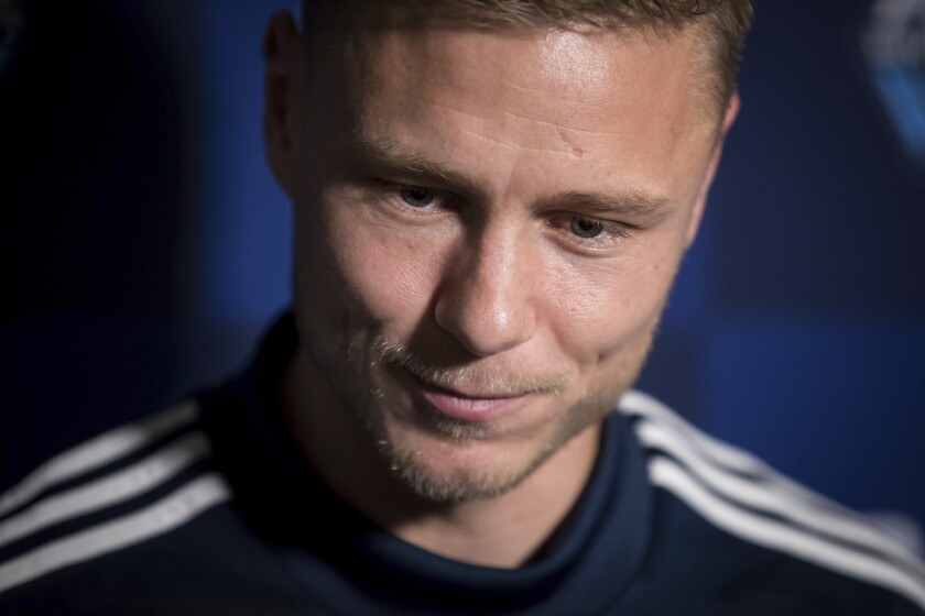 FILE - In this Jan. 21, 2019, file photo, Vancouver Whitecaps midfielder Andy Rose pauses while responding to questions during a media availability ahead of the MLS soccer team's training camp, in Vancouver, British Columbia. When the MLS Is Back tournament starts next week in Florida, the vast majority of the league's players will be taking part. For some, that includes balancing their own personal underlying health concerns with the opportunity to return to their profession. That includes the likes of Vancouver's Andy Rose and Seattle's Jordan Morris, who both have Type 1 diabetes. (Darryl Dyck/The Canadian Press via AP, File)