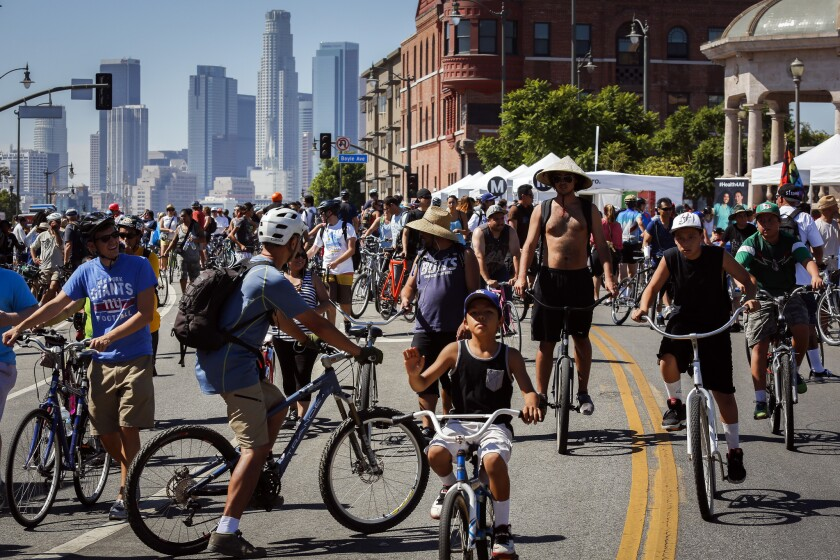 Cyclists, pedestrians and neighbors gather in Mariachi Plaza during Ciclavia on Oct. 5, 2014, in Los Angeles. (Patrick T. Fallon / For The Times)