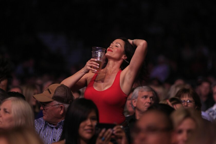Alan Jackson fans dance to the country music star during his 25th Anniversary Tour at the Valley View Casino Center.