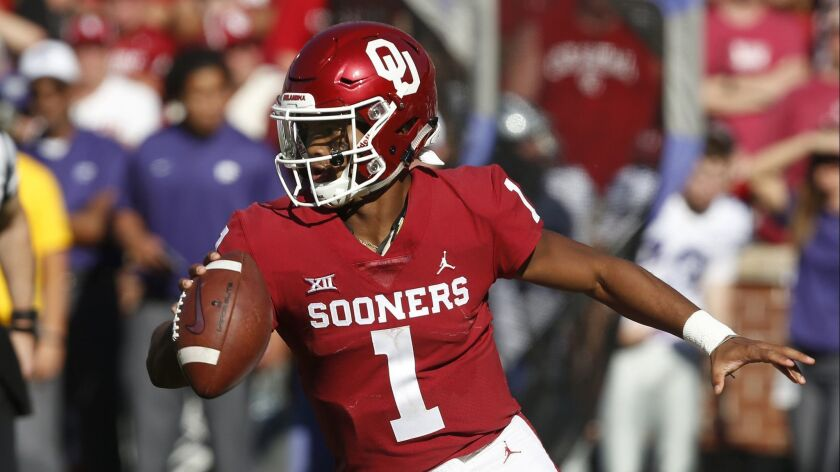 Heisman Trophy-winning quarterback Kyler Murray gave up baseball to pursue a career in pro football. He'll likely be rewarded by being selected by the Arizona Cardinals with the top overall pick in today's first round of the NFL Draft in Nashville. (AP Photo/Sue Ogrocki, File)