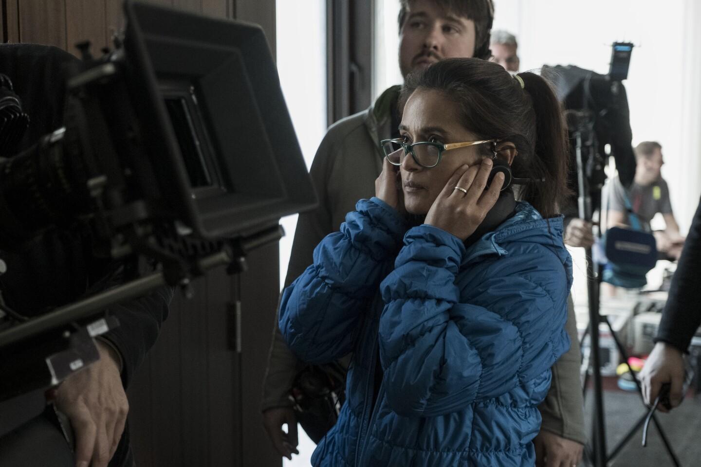 "Director Veena Sud behind the scenes on the set of ""THE LIE."" Credit: Jasper Savage/Amazon Studios"