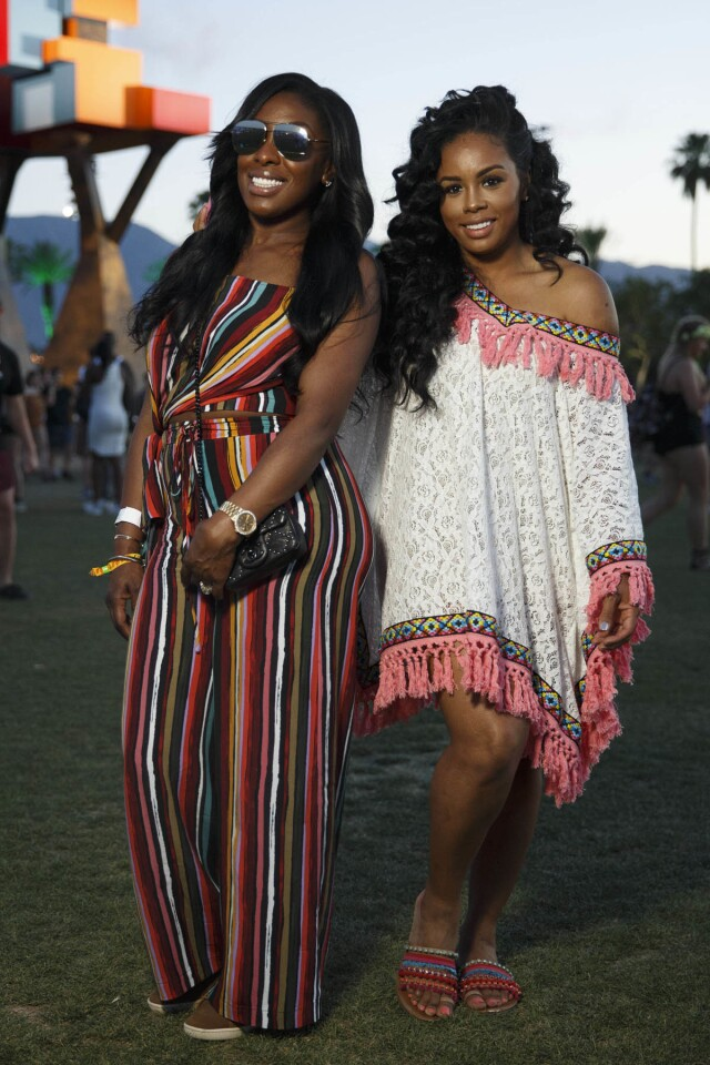 Chantel Mayo, 31, left from Boston and Tawana Morris, 32, went for coordinating pink-accented outfits with a striped jumpsuit and a lace fringed poncho, as they pose for a portrait during weekend one of the three-day Coachella Valley Music and Arts Festival at the Empire Polo Grounds on Saturday, April 15, 2017 in Indio, Calif. (Patrick T. Fallon/ For The Los Angeles Times)