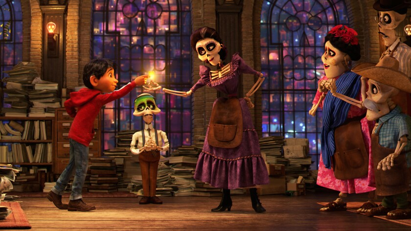 """Miguel (voiced by Anthony Gonzalez), a clerk (Gabriel Iglesias) and great-great grandmother Mamá Imelda (Alanna Ubach) in the animated movie """"Coco."""""""