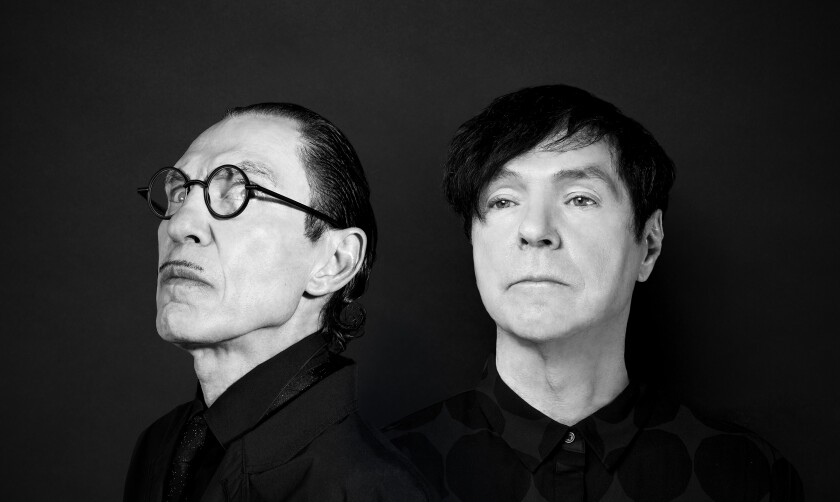 Portrait of brothers Ron and Russell Mael, both wearing all black