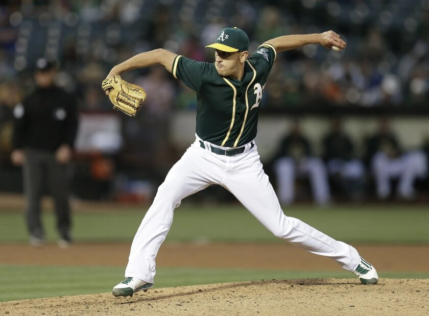 Oakland Athletics pitcher Pat Venditte works against the Texas Rangers during the fourth inning of a baseball game Wednesday, June 10, 2015, in Oakland, Calif. (AP Photo/Ben Margot)