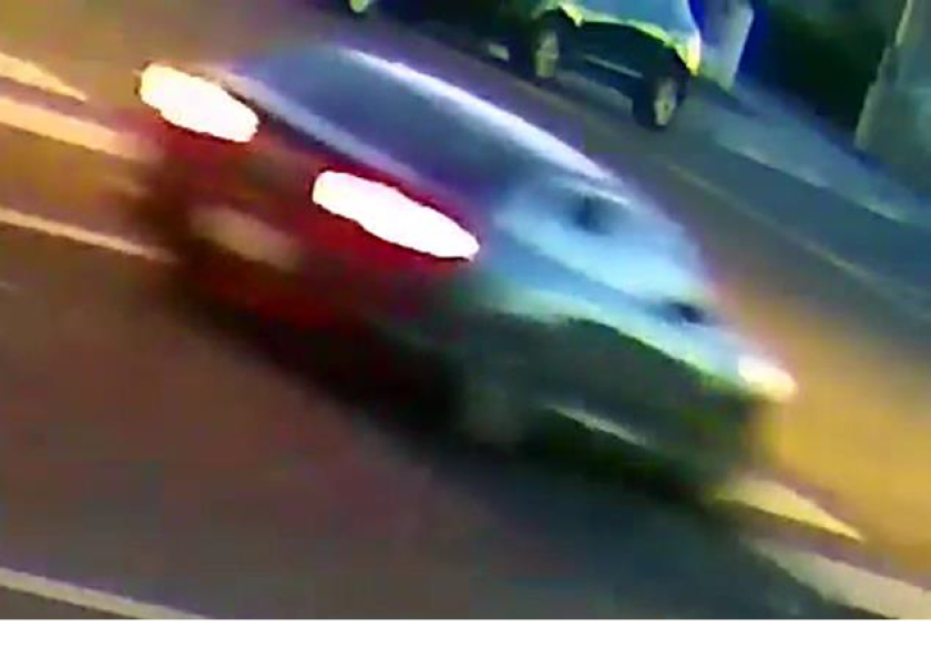 Surveillance image of car in street
