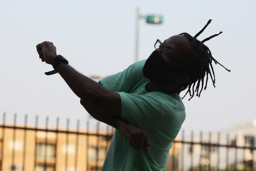 Martel Jackson practices a dance routine in the parking lot of a dance studio in North Hollywood.