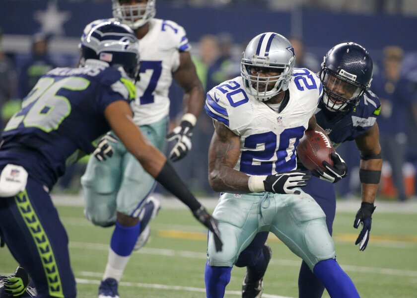 Seattle Seahawks' Cary Williams (26) moves to tackle Dallas Cowboys' Darren McFadden (20) after a short run by McFadden in the second half of an NFL football game Sunday, Nov. 1, 2015, in Arlington, Texas. (AP Photo/Brandon Wade)