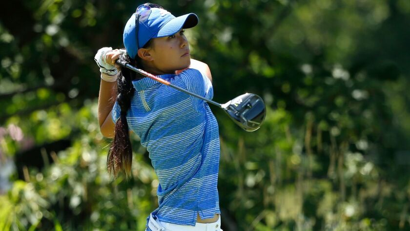 Danielle Kang watches her tee shot on the fifth hole during the final round of the Women's PGA Championship golf tournament at Olympia Fields Country Club in Olympia Fields, Ill.